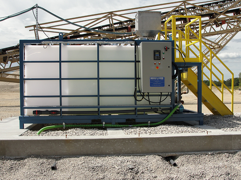 Clearwater Industries Model 800PP polymer make-down system in use at an aggregate site where it helps settle wastewater particles for water clarification.