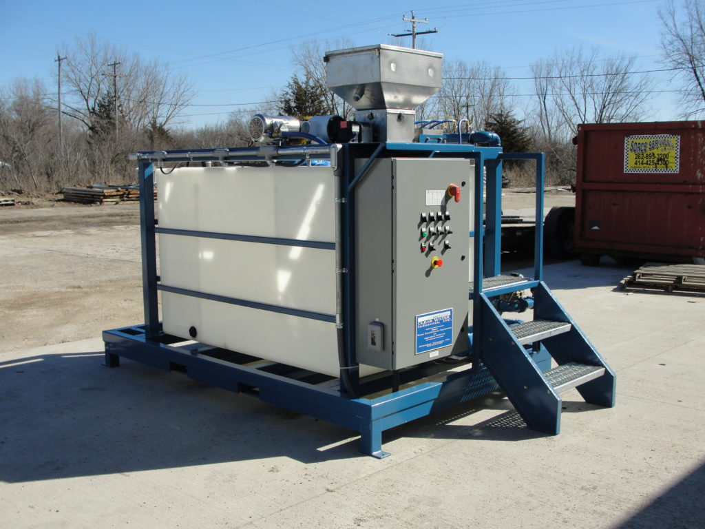 Clearwater Industries Model 300PP displays it's control panel, dry polymer hopper and operator staircase.