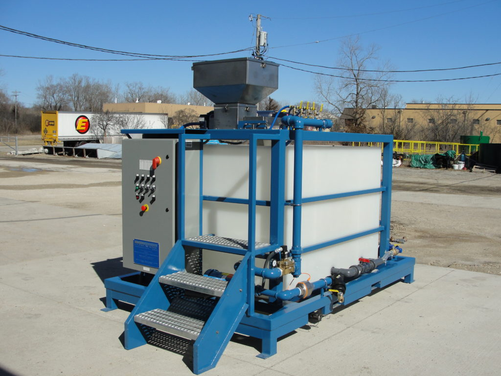 Clearwater Industries Model 300PP outside showing it's control panel, dry polymer hopper, operator staircase and pump system.