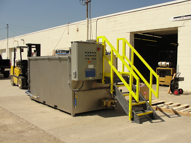Clearwater Industries Model 800 Stainless Steel polymer make-down system displaying it's control panel and operator staircase to feed the dry polymer.