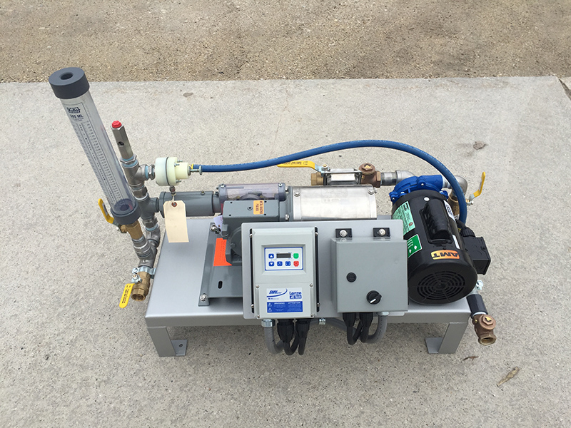 This is an image of Clearwater's LQ50 which is a liquid polymer dosing system that features a dilution water pump, neat polymer pump, calibration column, VFD control and components.