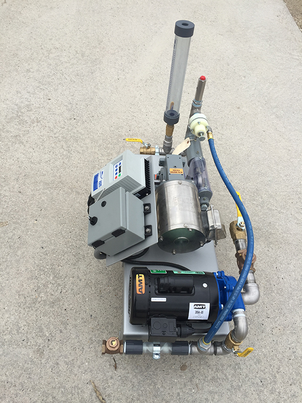 A side view of Clearwater's LQ50 liquid polymer dosing system on a concrete pad.