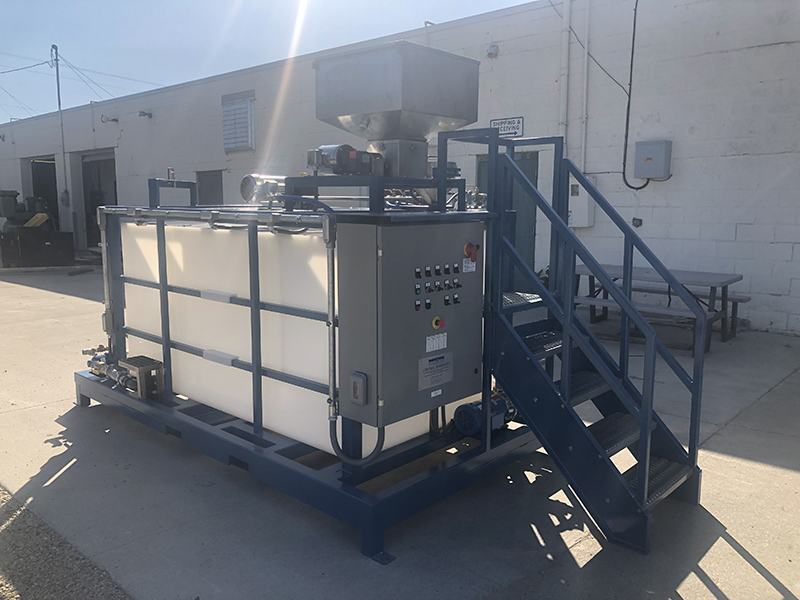 Clearwater Industries Model 500PP polymer make-down system pictured outside to show it's control panel and dry polymer hopper.