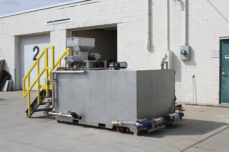 Clearwater Industries Model 500 Stainless Steel polymer make-down system pictured from the side to display it's pump system, polymer hopper and dry polymer feed system.