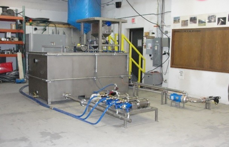 Clearwater Industries Model 500 Stainless Steel PLC polymer make-down system in the manufacturing dept. to displayed the custom pump system designed for the client.