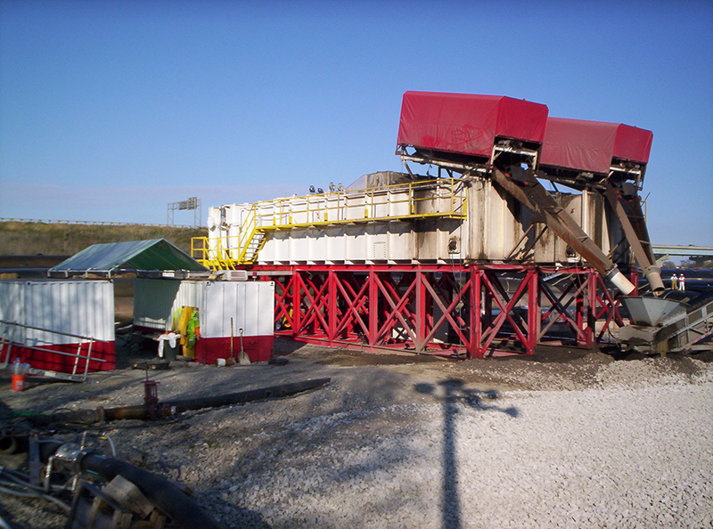 Two large clarifiers treat water and remove contaminated sediment at an environmental clean-up site.