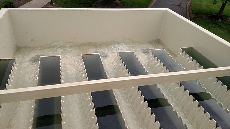 Pretreated water running over weirs and into a clean water tank before it's treated to become high purity water.