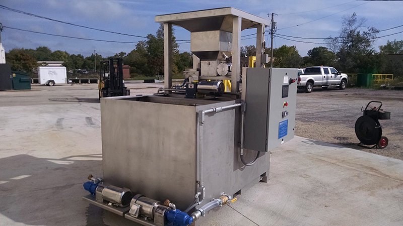 A picture Clearwater Industries Model 300 Stainless Steel PLC with it's big bag pan to hopper feed and pump system.
