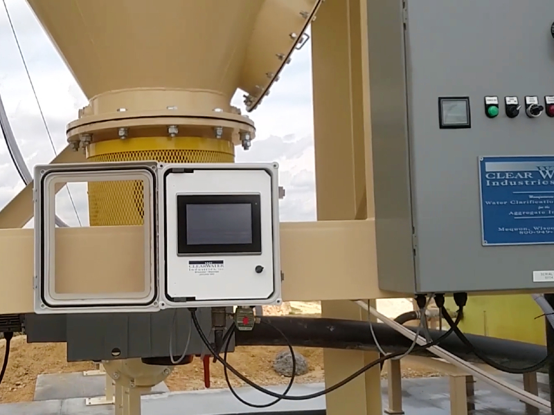 A picture showing Clearwater's AutoFloc messenger mounted to a water clarifier that cleans water for a sand producer.