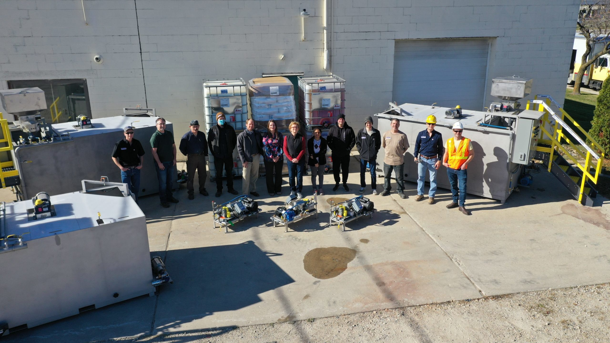 Clearwater employees proudly standing by their in stock wastewater equipment