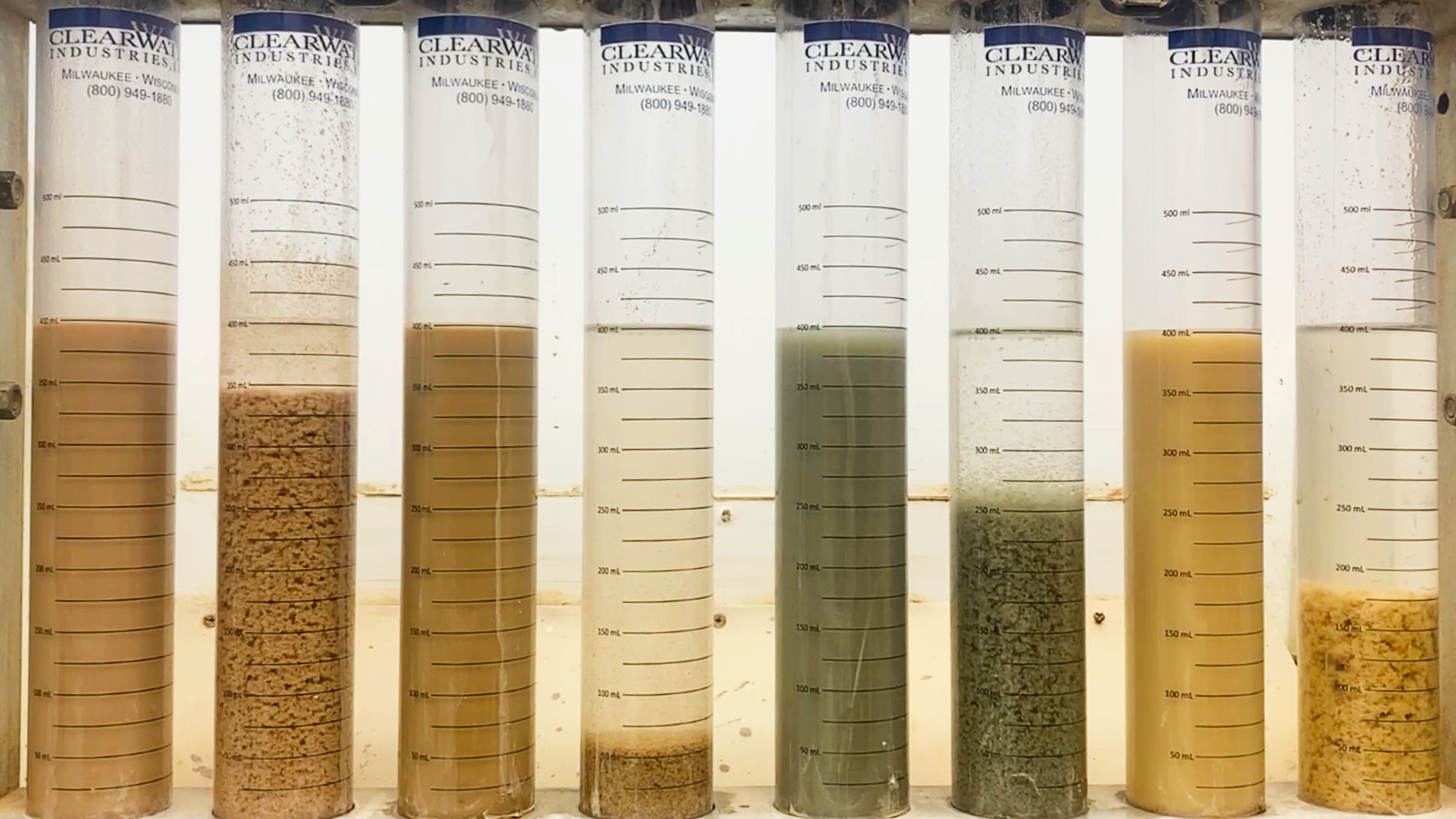 A polymer jar test picture with many different slurries being tested to show how different slurries react to polymer dosing.