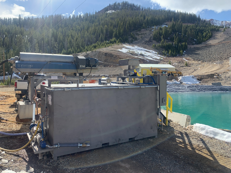 The side of a dry polymer preparation unit next to a pond at a gold mining operation.