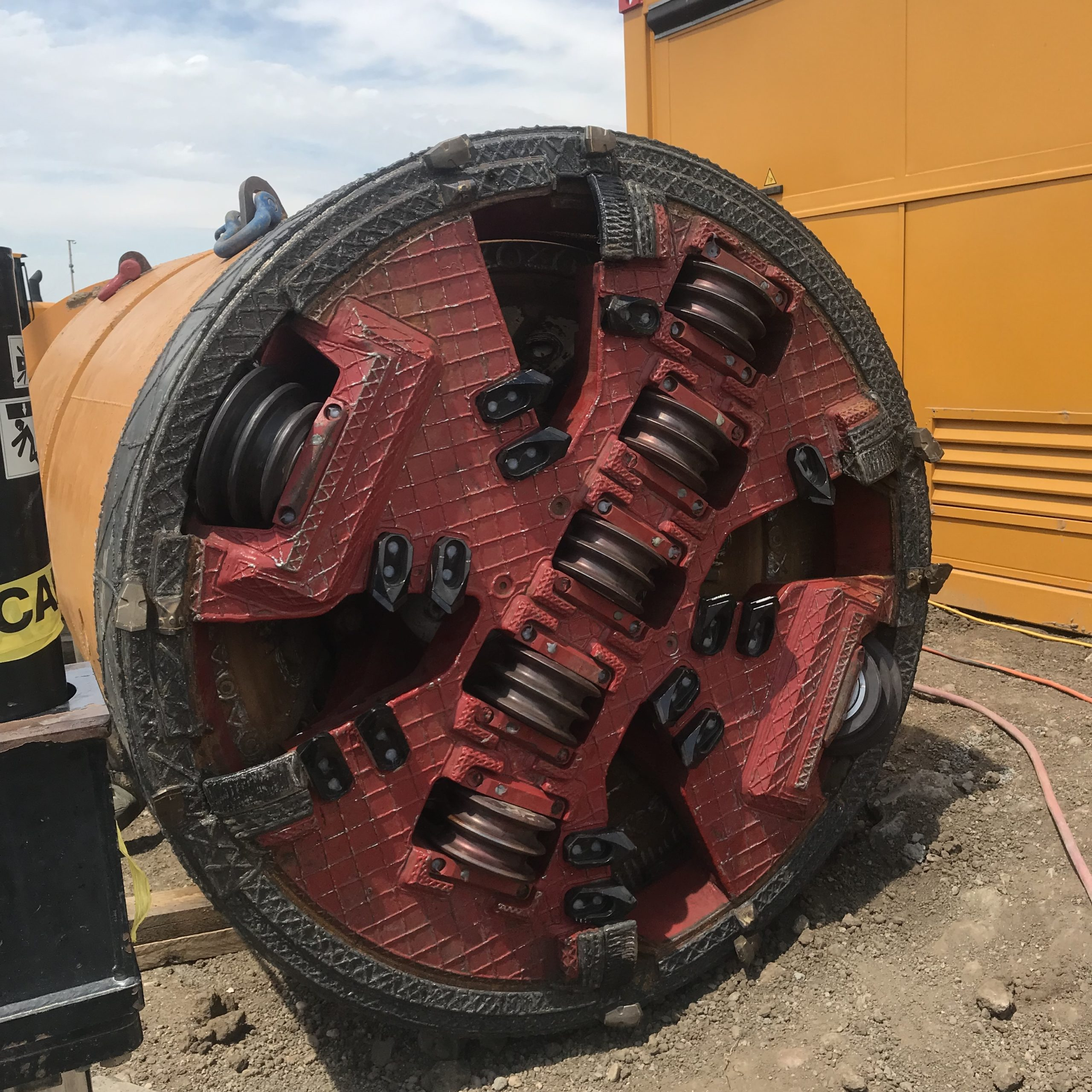 The front of a microtunneling boring machine at a job site.