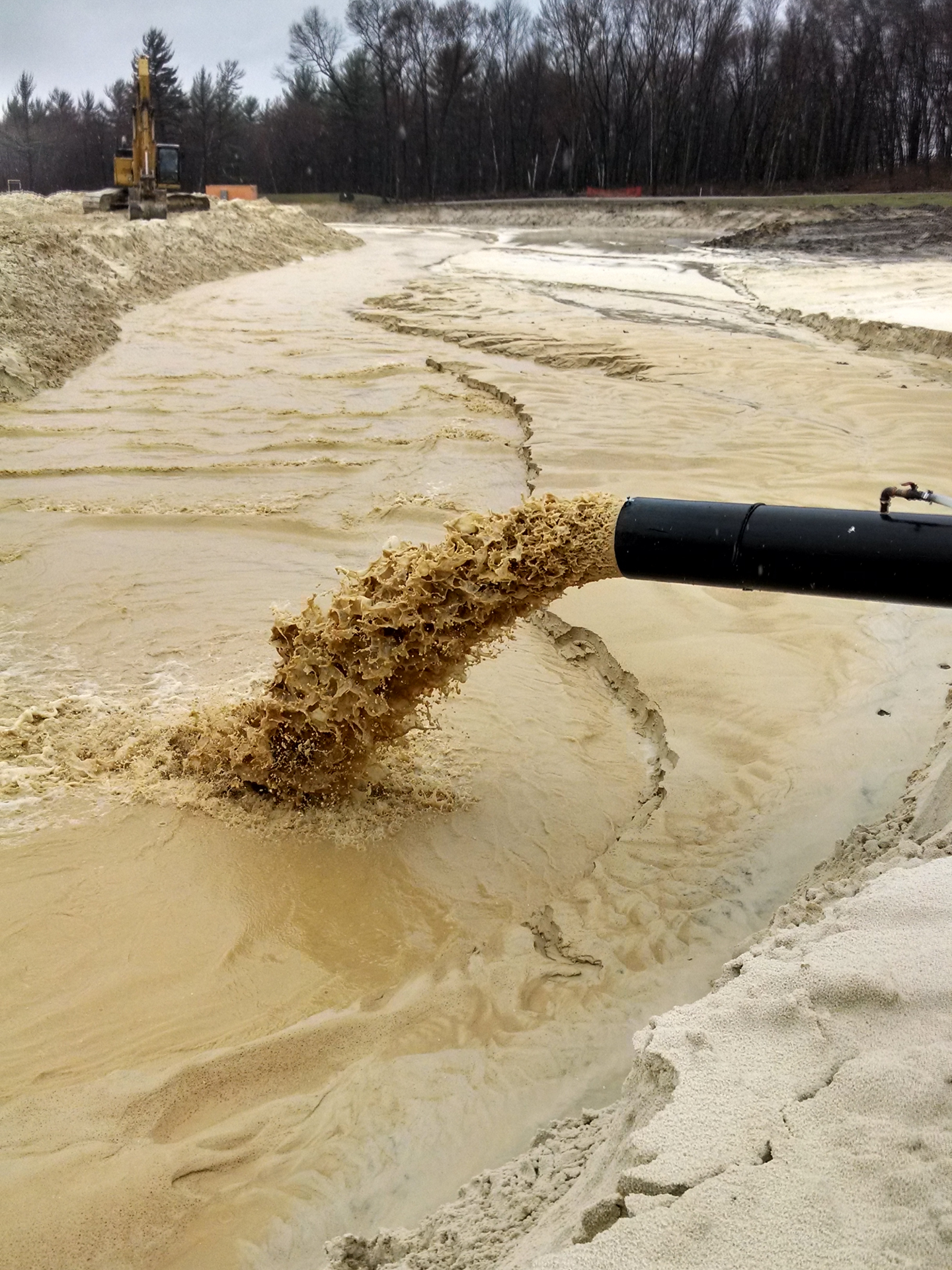 Wash water for an industrial sand washing plant is discharged into a settling basin.