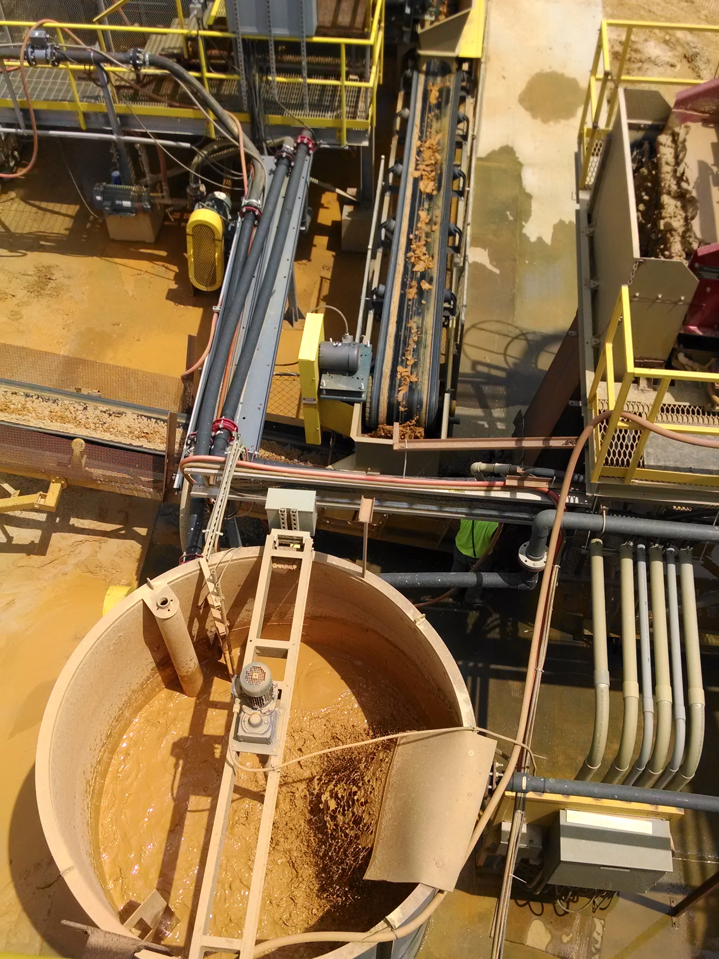 An above view of a section of a sand washing plant with conveyor belts taking aggregates to different locations.