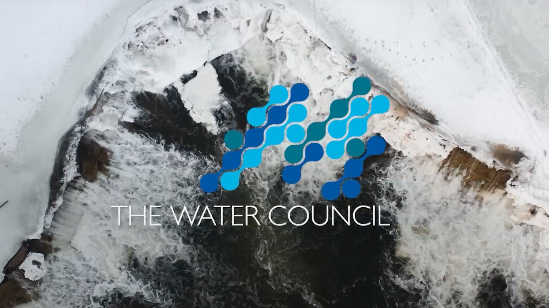 A water fall in winter shot from above by a drone with The Water Councils logo overlayed.